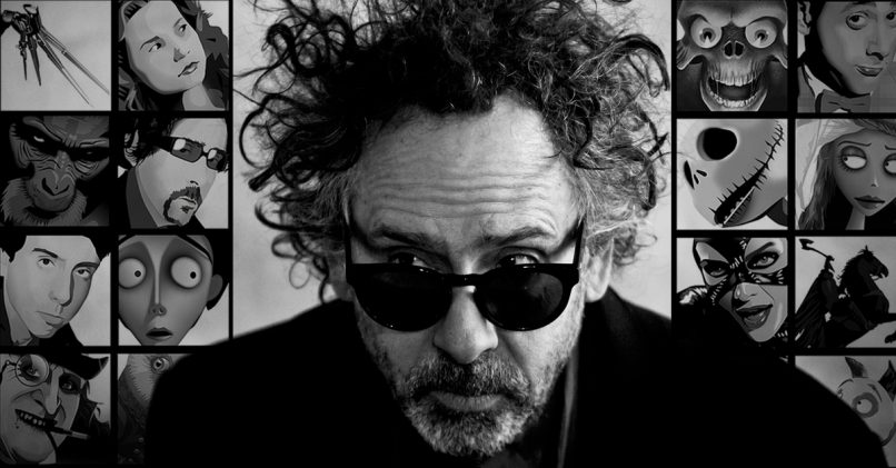 Tim Burton with pictures of his characters.